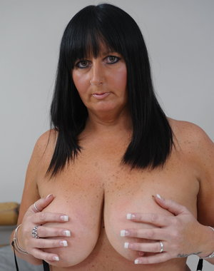Chubby mature slut showing her big boobs