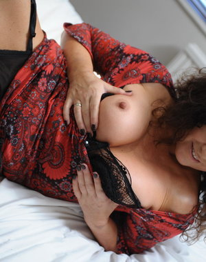 Big breasted MILF getting naughty as hell