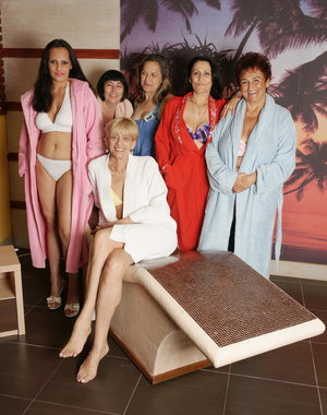 Lovely mature ladies relaxing and getting naked in the sauna