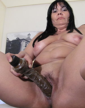 Hot mature slut playing with her big dildo