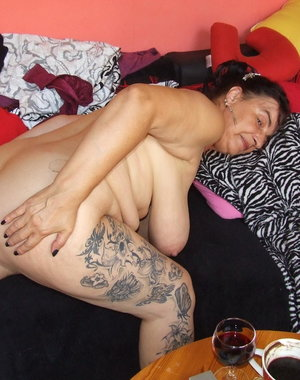 Horny tattooed mature slut getting naked