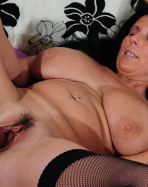 Big breasted mama showing off her dirty mind
