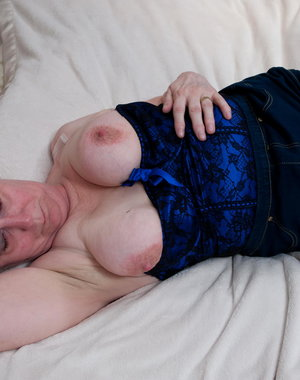 Naughty mom playing alone on her bed