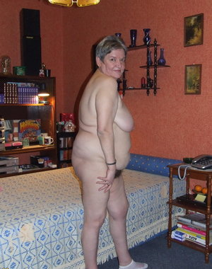 This housewife loves getting naked for us