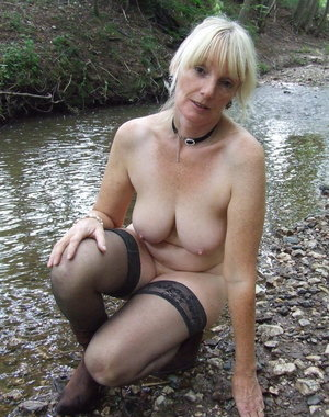 Naughty mature slut getting naked in the woods