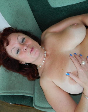 Big breasted housewife playing all alone