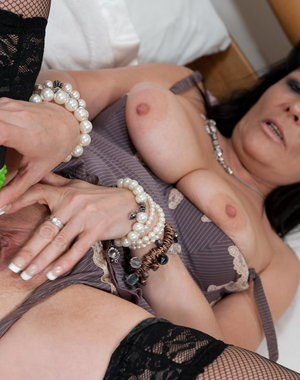 Kinky mature slut with her green dildo