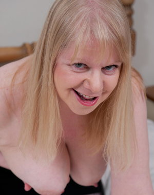 Big breasted mature slut having a good time