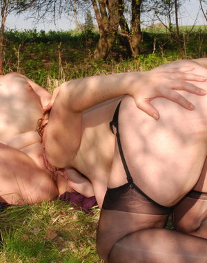 Two old and young lesbians have fun in the open air