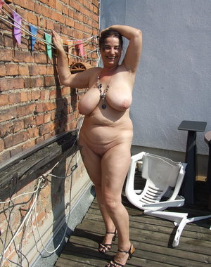 naughty housewife getting naked on her roof