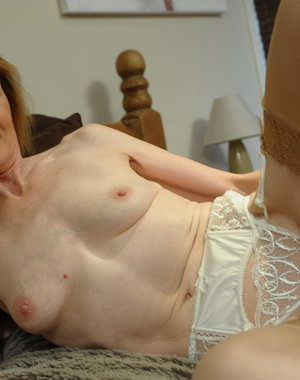 This lovely housewife plays with her pussy