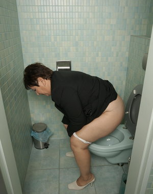 Chubby mama getting naughty on a toilet