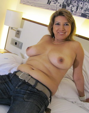 Hot mature lady getting naked and naughty