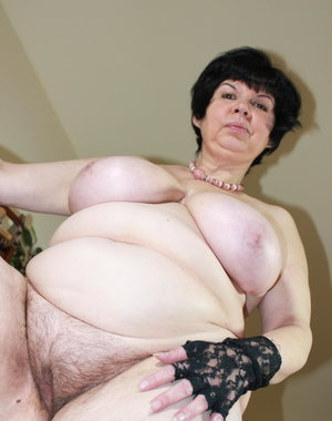 Big breasted mature slut goes naked and naughty