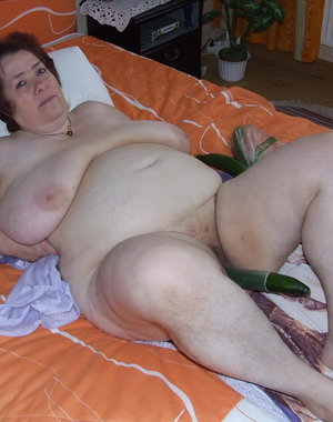 Big mama getting naughty on her bed