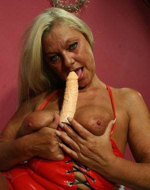 Blonde mature nympho getting naugty with her toy