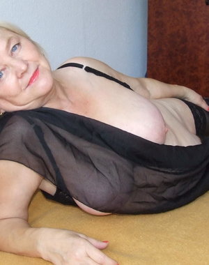 Big titted mama getting naked on her bed