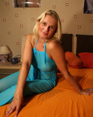 Blonde housewife playing on the bed