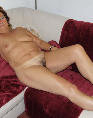 This hairy mom is getting naked and frisky