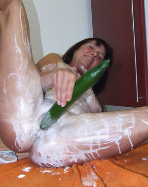 Kinky housewife playing with some whipped cream