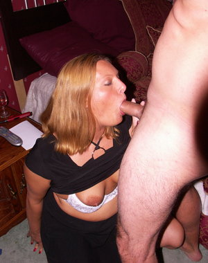 Hot American housewie sucking on cock