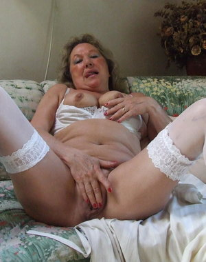 Kinky mama stripping in her living room