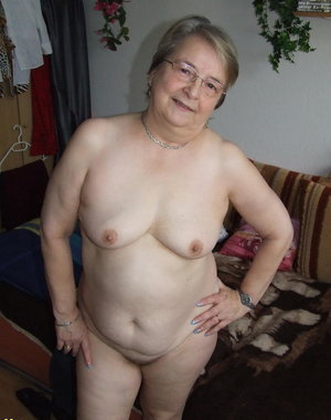 Granny takes off all of her clothes and starts playing