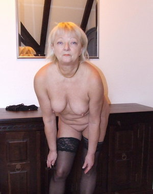 Amateur older lady stripping of all her clothes