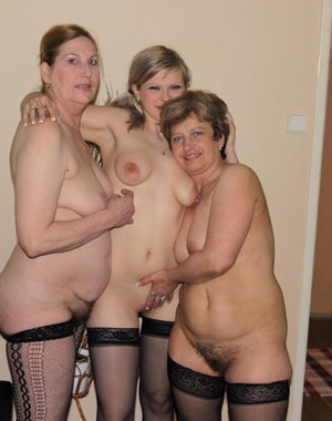 Two older sluts love to get down on a hot babe