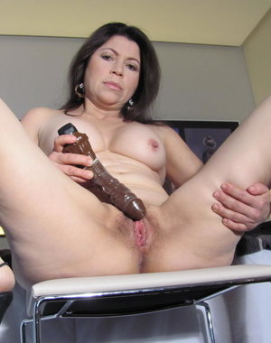 Hot mature slut playing with a dildo