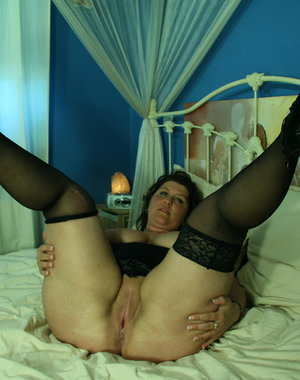 This big breasted mature slut plays with herself