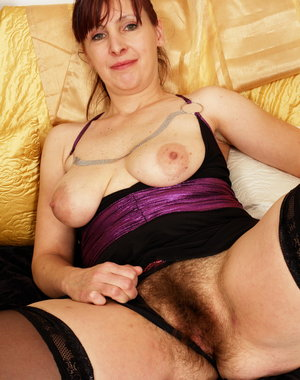 Hairy mature slut playing with her dildo