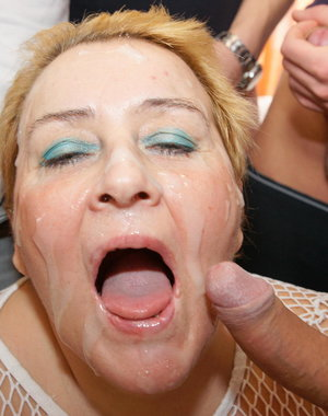 This horny mature slut loves seven cocks at once