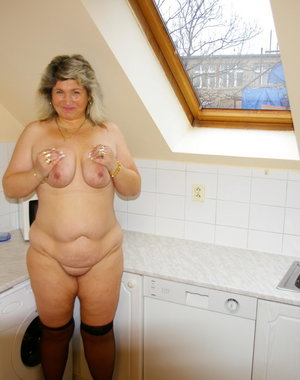 Big titted mama playing with herself in the kitchen