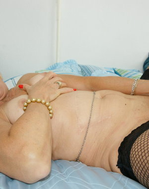 Kinky European mama playing with her pussy