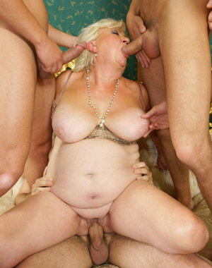 Kinky mature slut takes on five hard cocks