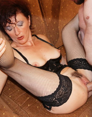 Kinky mature slut doing her maleslave hard