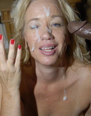 This blonde mature slut loves to get two black cocks at once