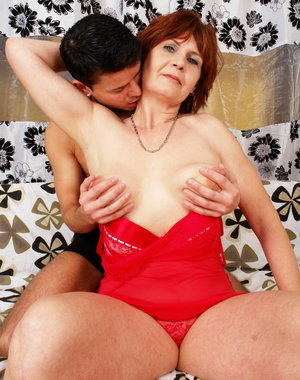 This horny granny gets a lot of love from her toy boy