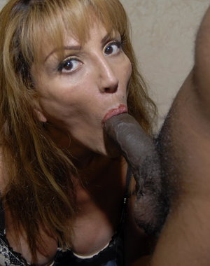 This kinky mature slut loves to get two black cocks at once