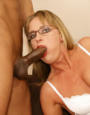 This dripping mature cunt loves her cocks black and hard