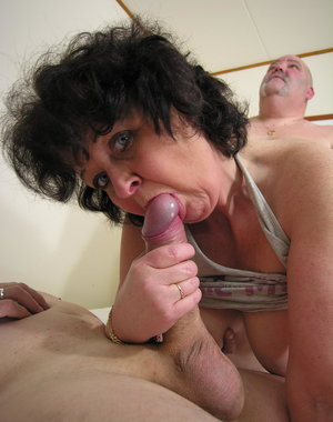 This horny mama loves the kinky attention from two men
