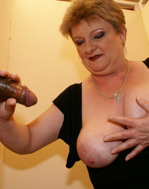 This chunky big titted mature slut loves a cock through a hole