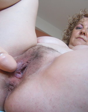 Big titted mature slut taking on her rubber toy