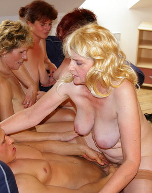 Horny mature sluts sharing one hard cock