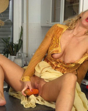This horny housewife really loves her vegetables