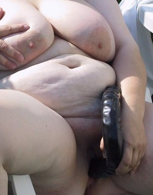 This big mature woman loves playing with toys in the garden