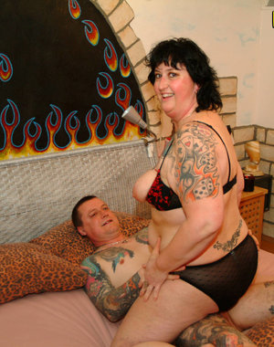 Mature tatooed couple having red hot firey sex