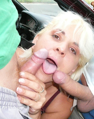 Big titted mature slut sucking cocks alongside a highway