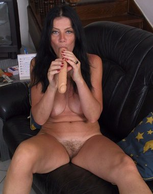 mature slut playing with herself on the couch